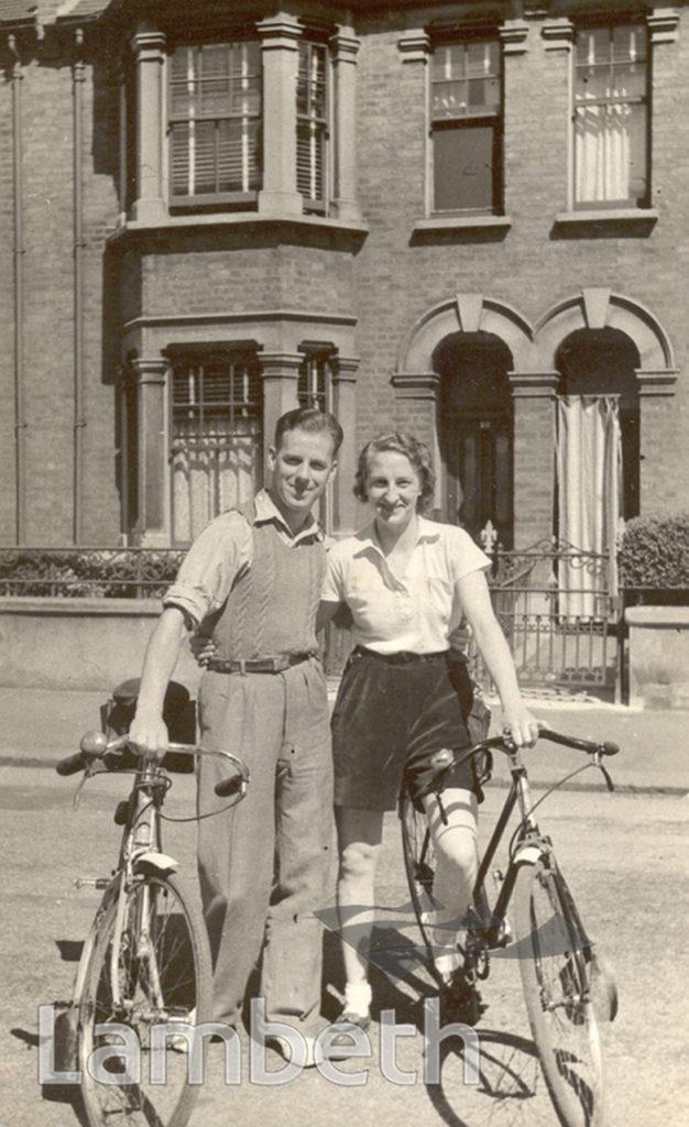 COUPLE WITH BICYCLES, HYDETHORPE ROAD, BALHAM