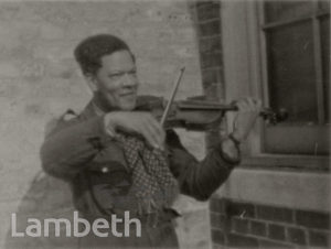 CIVIL DEFENCE MEMBER PLAYING VIOLIN: WORLD WAR II