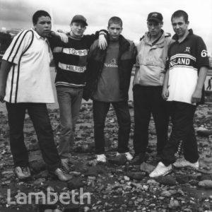 TEENAGERS ON THAMES FORESHORE, WATERLOO