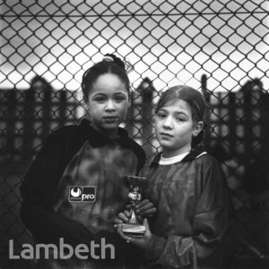 GIRLS WITH FOOTBALL TROPHY, FERNDALE ROAD, BRIXTON