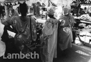 WOMEN IN AFRICAN DRESS, BRIXTON MARKET, BRIXTON