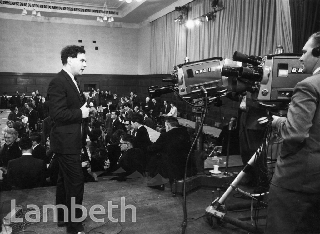 BBC TV PRESENTER AT G.L.C. ELECTION COUNT, LAMBETH TOWN HALL