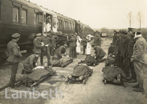 OFFICIAL WWI PHOTOGRAPH: WOUNDED AT AMBULANCE TRAIN, FRANCE