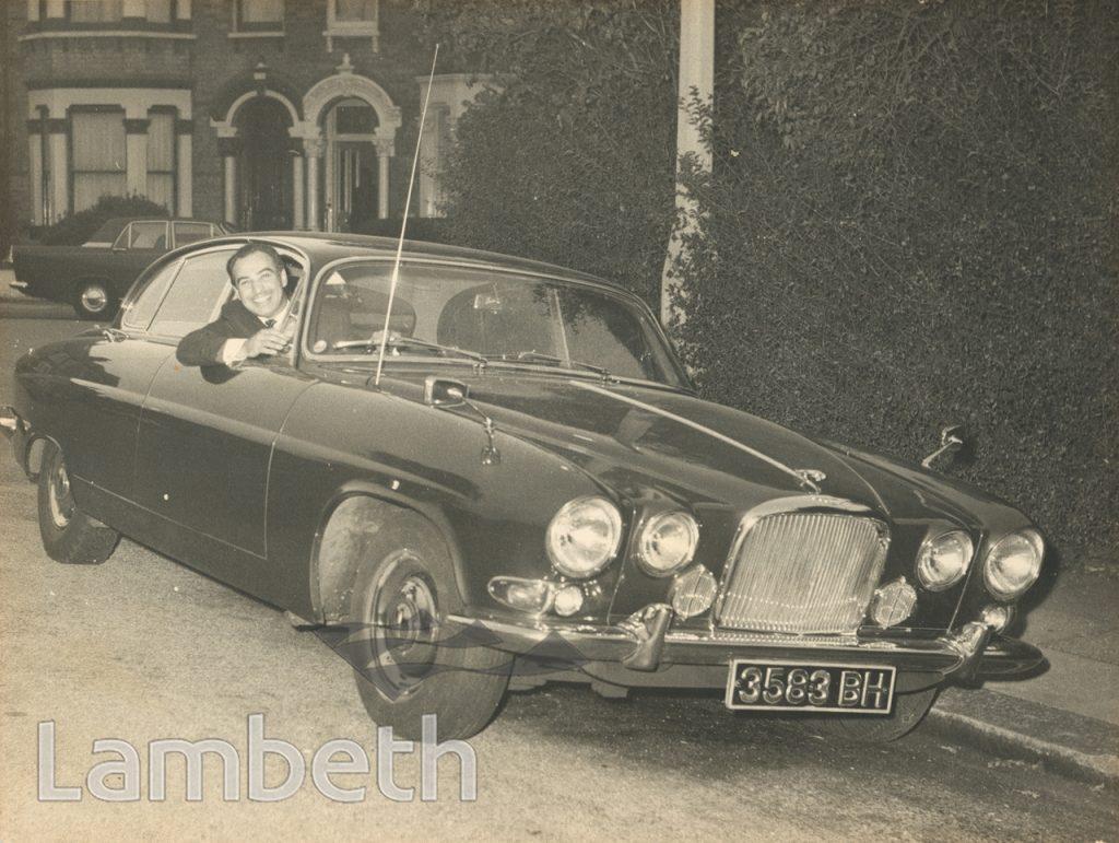 HARRY JACOBS IN JAGUAR CAR
