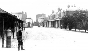 Royal Victoria Yard Main Gate centre, The Colonnade right