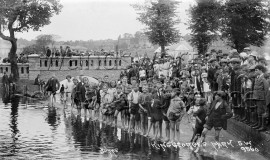 King George's Park – group of barefoot children by river
